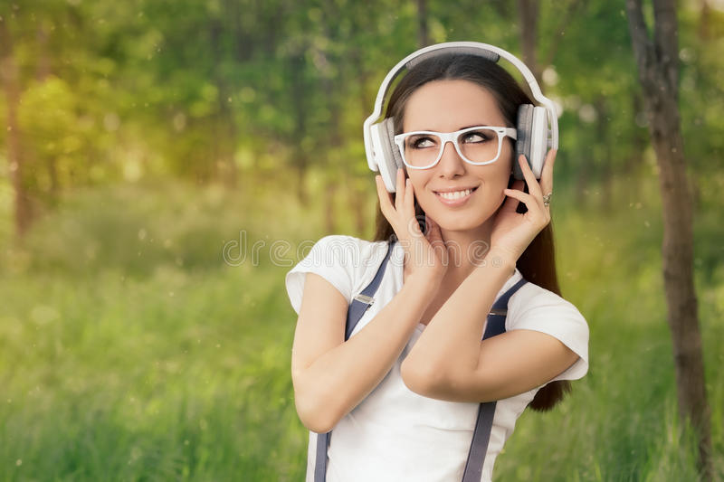 Girl with Headphones Listening to Music royalty free stock image