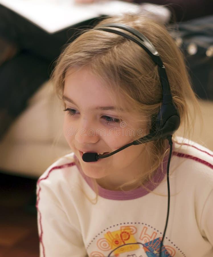 Girl and headset stock photo