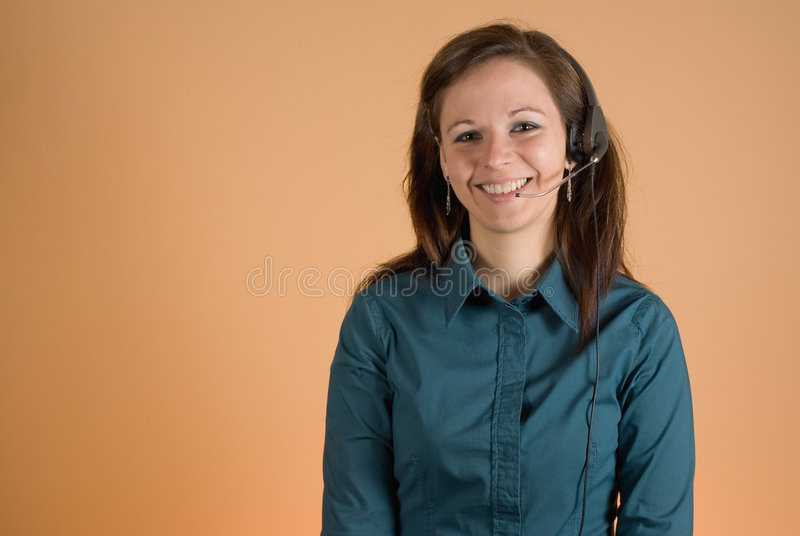 Girl with headset. Young attractive girl smiling with headset on royalty free stock photography
