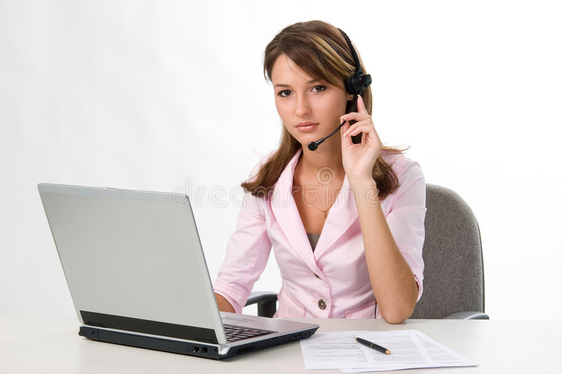 Girl with headset and laptop royalty free stock photography