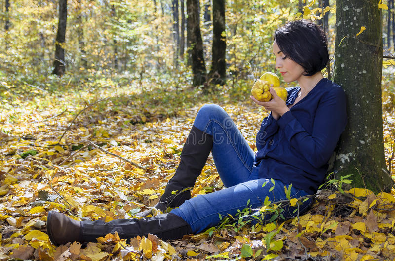 Girl with health quinces stock photography
