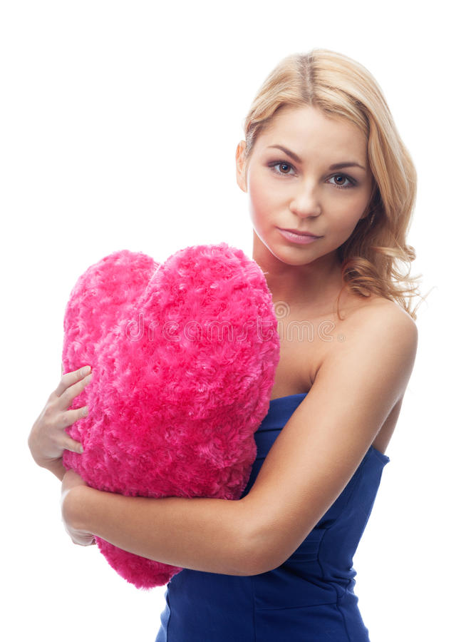 Girl With Heart Shape Pillow Stock Images