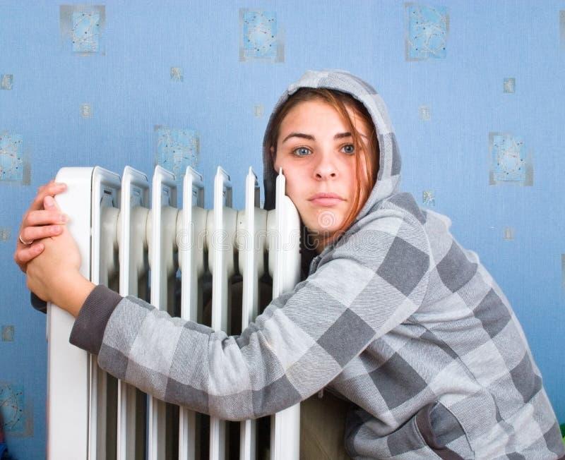 Girl and heater stock photos