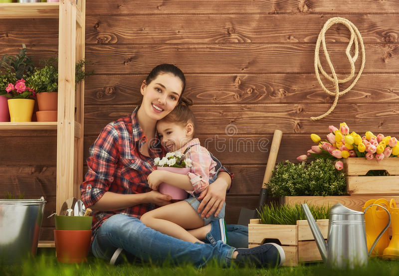 Girl helps her mother royalty free stock photos