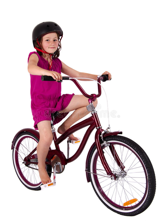 Girl on her bicycle royalty free stock photography
