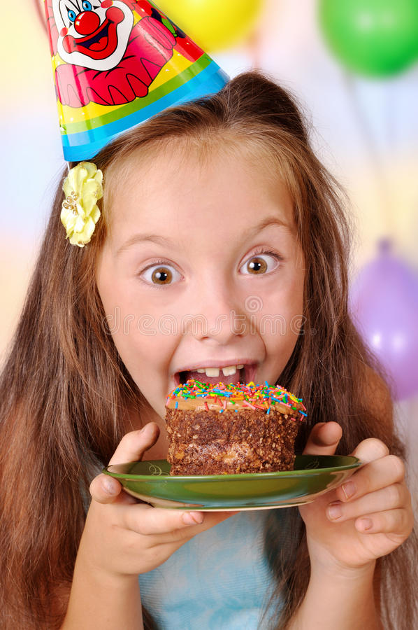 Girl in her birthday cake absorbs. The girl in her birthday cake absorbs stock photos