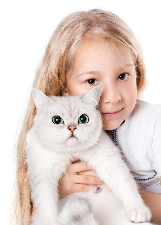 Girl and Her Cat. 7-8 years old girl holding white cat stock photos