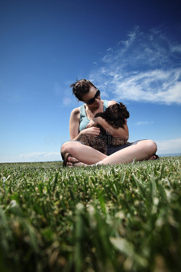Download Girl and her dog stock image. Image of green, cockapoo - 11724783