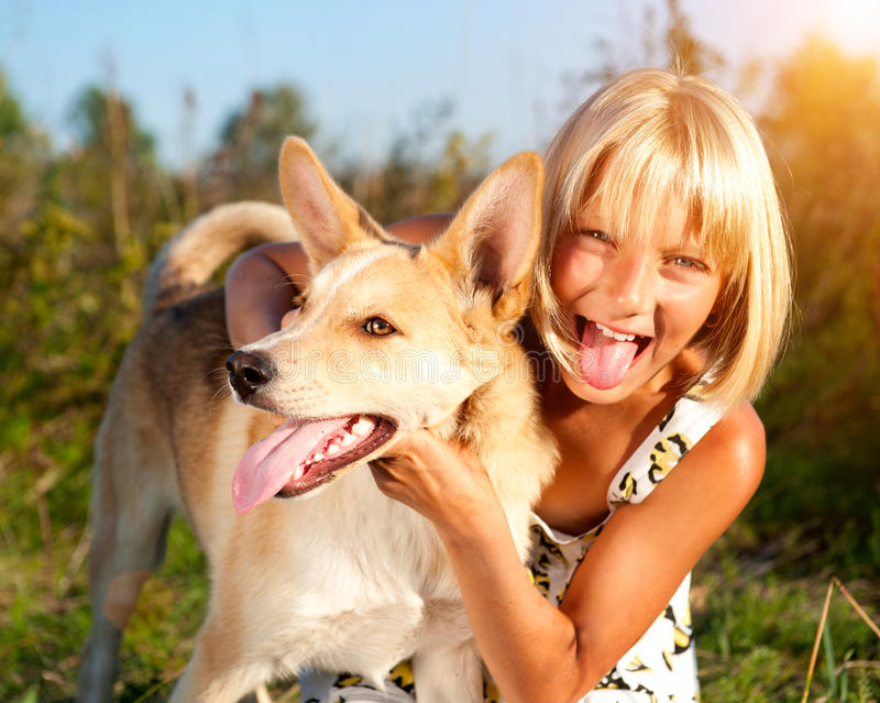 Girl with her dog together. Friendship concept royalty free stock image