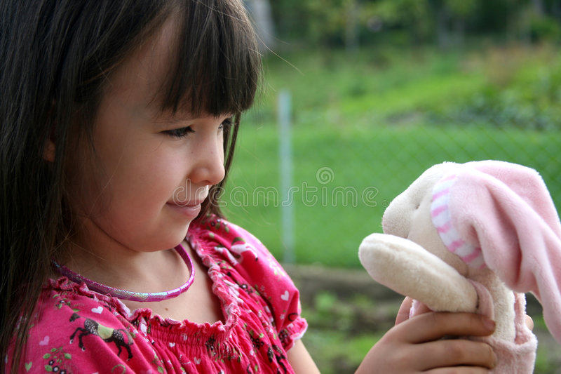 Download Girl and her doll stock image. Image of gazing, pink, girl - 1587467
