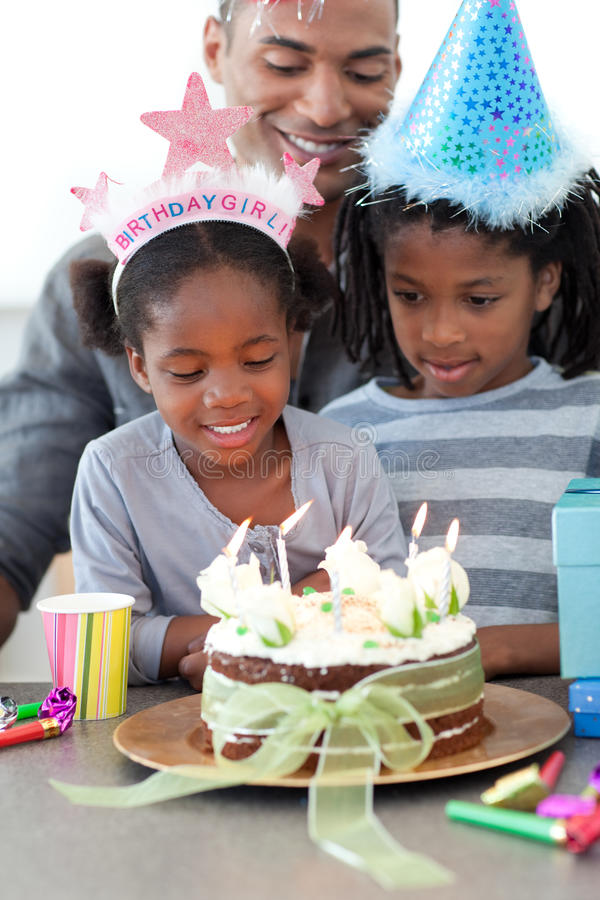Girl and her family celebrating her birthday royalty free stock image