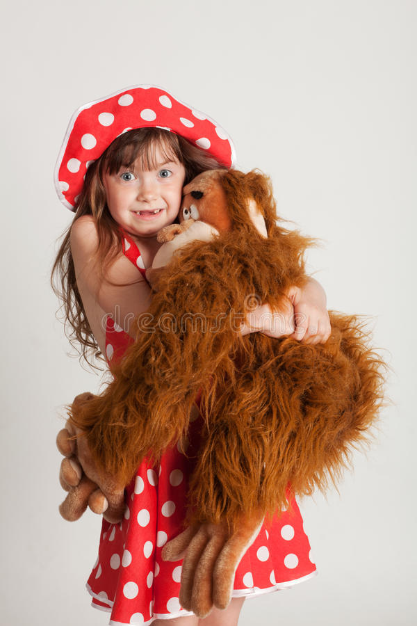 Girl with her favorite toy stock photography