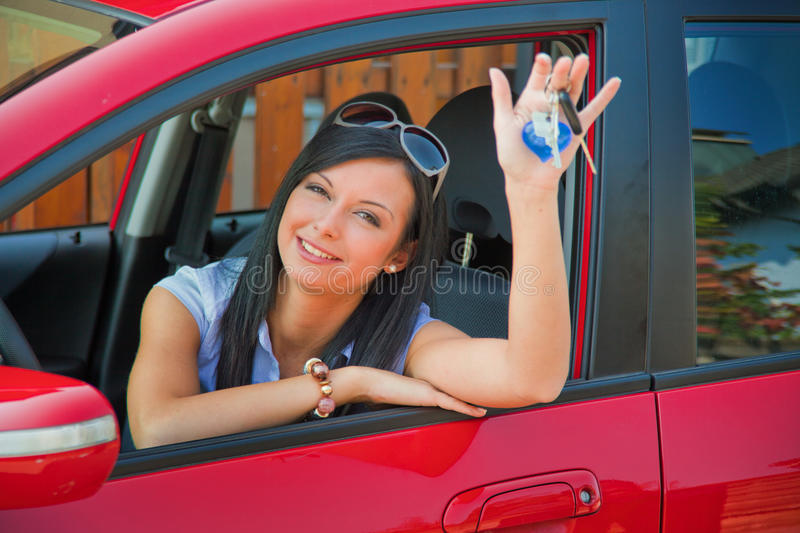 Girl with her first car. A teenage girl with her first car stock photo