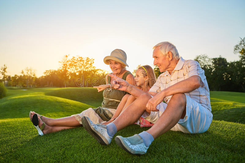 Girl and her happy grandparents. stock images