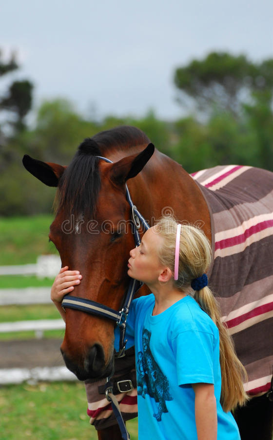 Girl and her horse royalty free stock photography