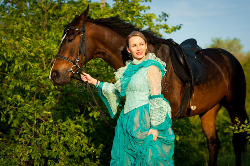 Girl and her horse. royalty free stock photography