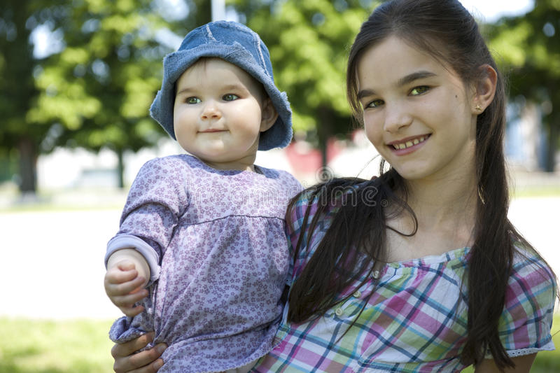 Download Girl With Her Little Sister Stock Photo - Image: 26220624