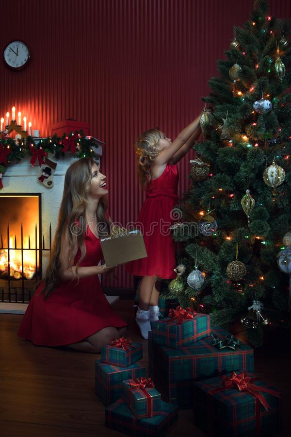 Girl with her mama in christmas environment stock photos