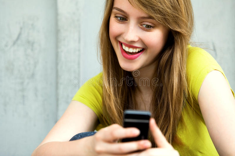 Girl with her mobile phone. Woman Using Mobile Phone, smiling