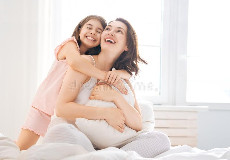 Girl and her mother enjoying sunny morning stock photos