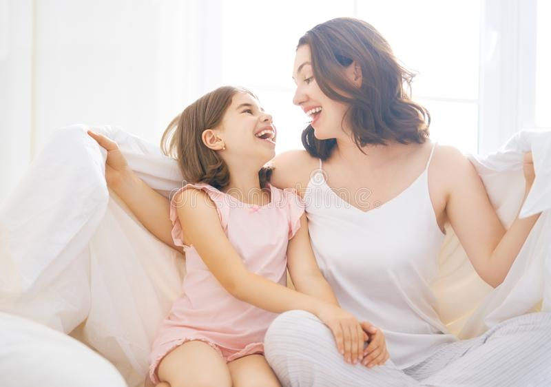 Girl and her mother enjoying sunny morning royalty free stock photography