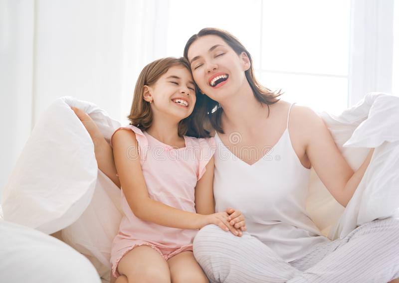 Girl and her mother enjoying sunny morning stock photo