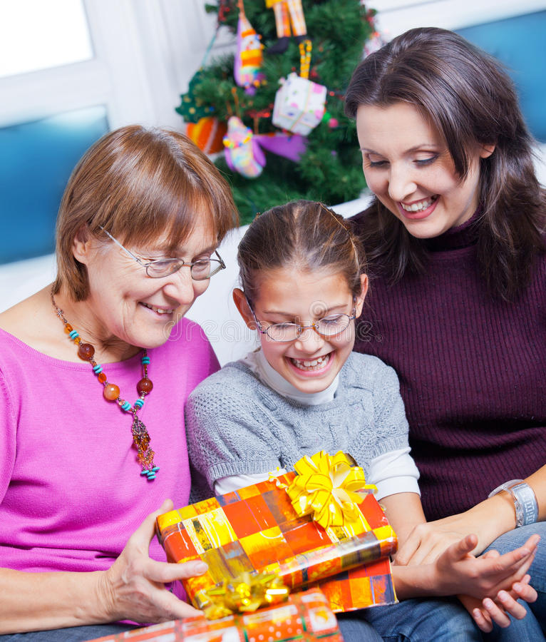 Download Girl And Her Mother And Grandmother With Gifts Stock Photos - Image: 22552523