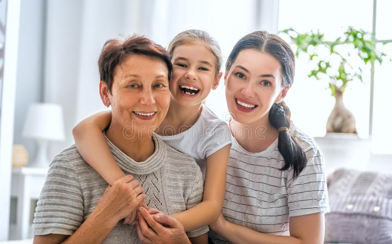 Girl, her mother and grandmother stock images