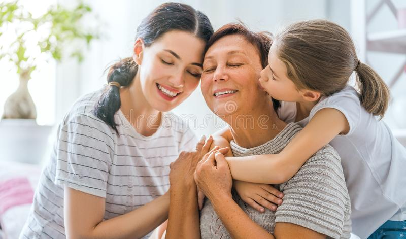 Girl, her mother and grandmother royalty free stock photography