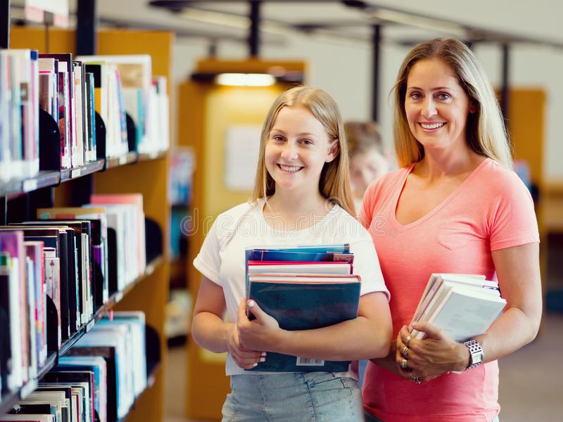 Girl and her mother in library royalty free stock photos