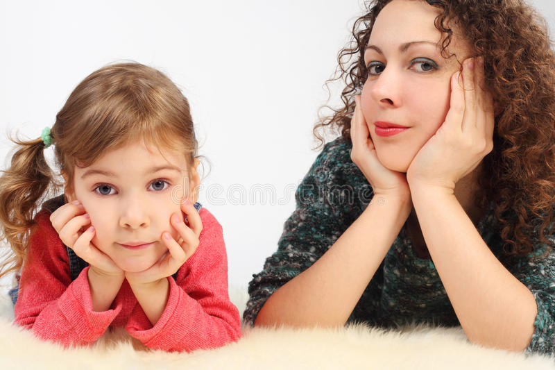 Download Girl And Her Mother Lies On White Fell Stock Photo - Image: 15656730
