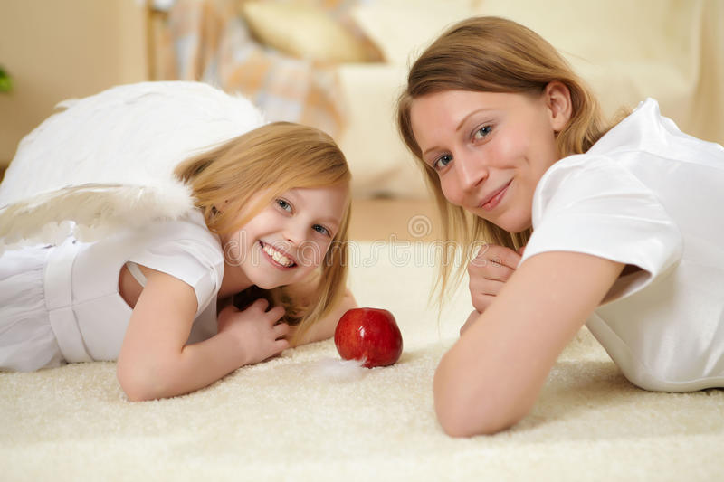 Girl and her mother with a present royalty free stock photography
