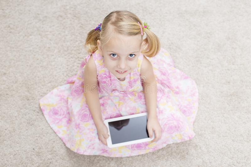 Girl with her own tablete royalty free stock images