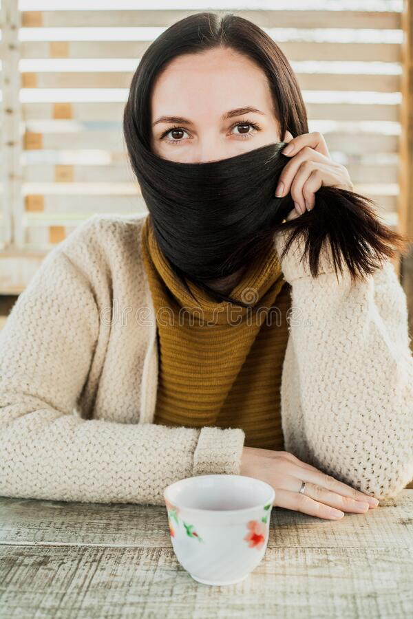 Girl hid her face with hair.quarantine.  stock photography