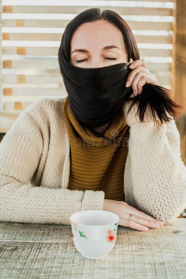 Girl hid her face with hair.quarantine. Closed her eyes royalty free stock image