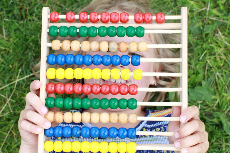 Download Girl Hiding Behind An Abacus Stock Photography - Image: 25515882