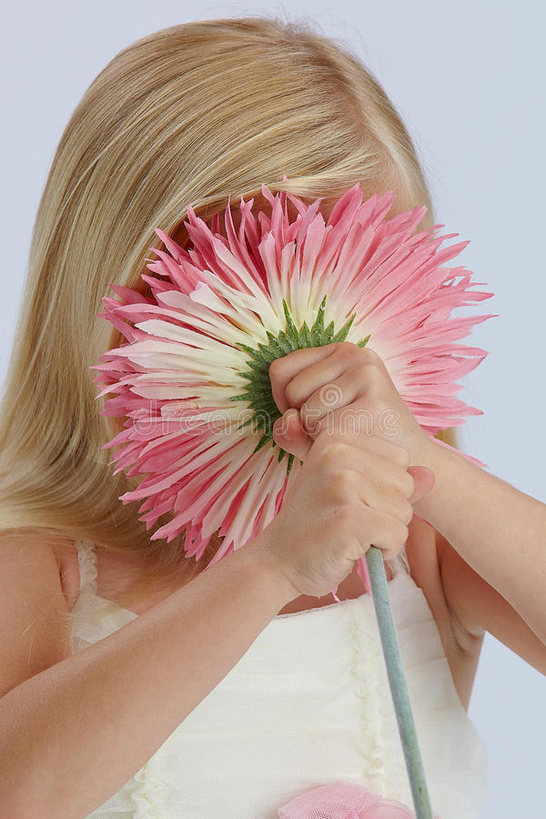 Download Girl hiding behind flower stock image. Image of cute - 21561013