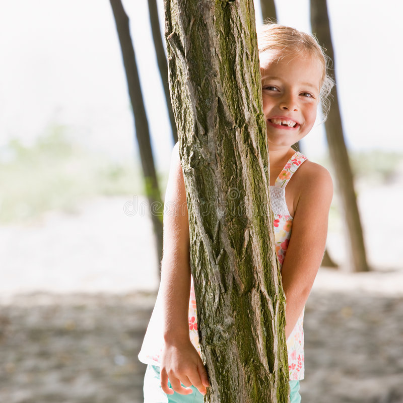 Download Girl Hiding Behind Tree Royalty Free Stock Images - Image: 7423069