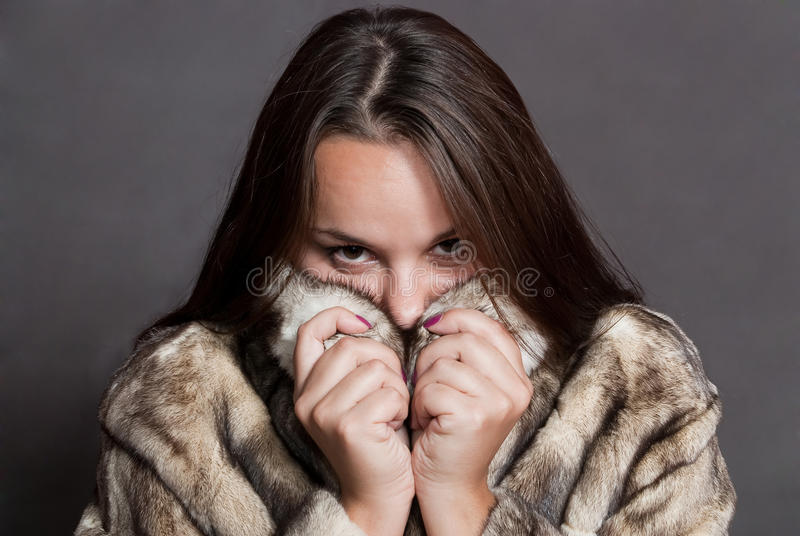 Download Girl Hiding In Fur Coat Stock Photos - Image: 11437453