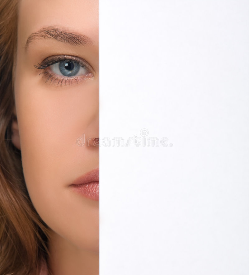 Girl Hiding Under Sheet Of Paper Royalty Free Stock Images