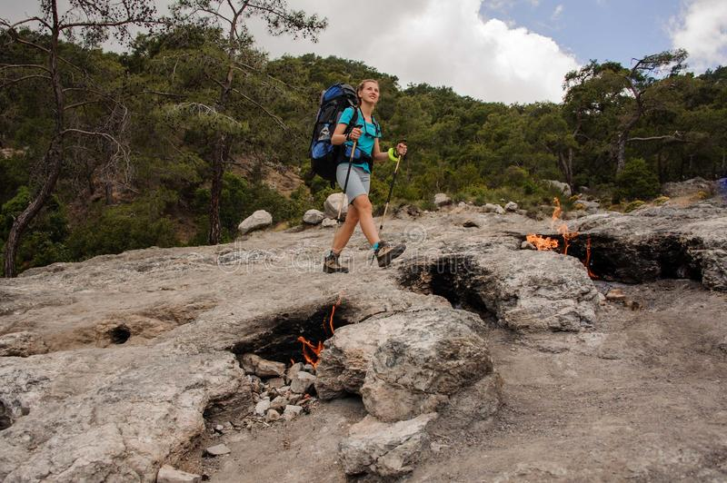 Girl with hiking backpack walking on the rocks of the Chimaera mountain stock images