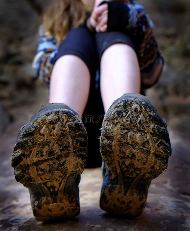 Girl Hiking Boots Mud Sitting on Rock royalty free stock photos
