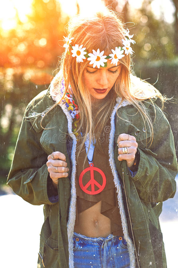 Girl hippie revolutionary 1970 style. Picture ruined simulation royalty free stock photography