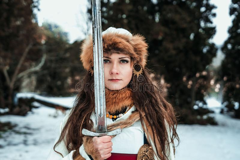 Girl in historical clothes with a sword royalty free stock photos