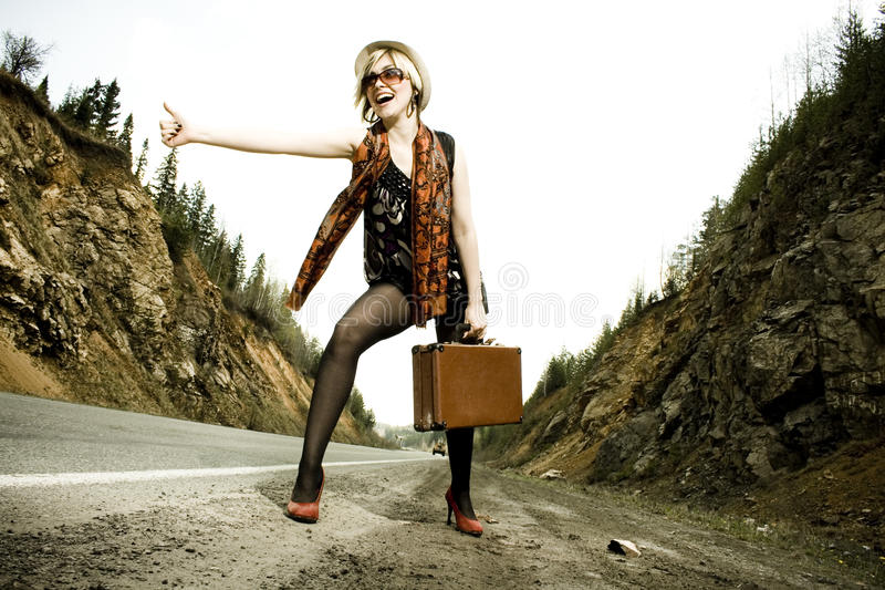 Download Girl Hitchhiking With Suitcase Stock Photo - Image: 15237032