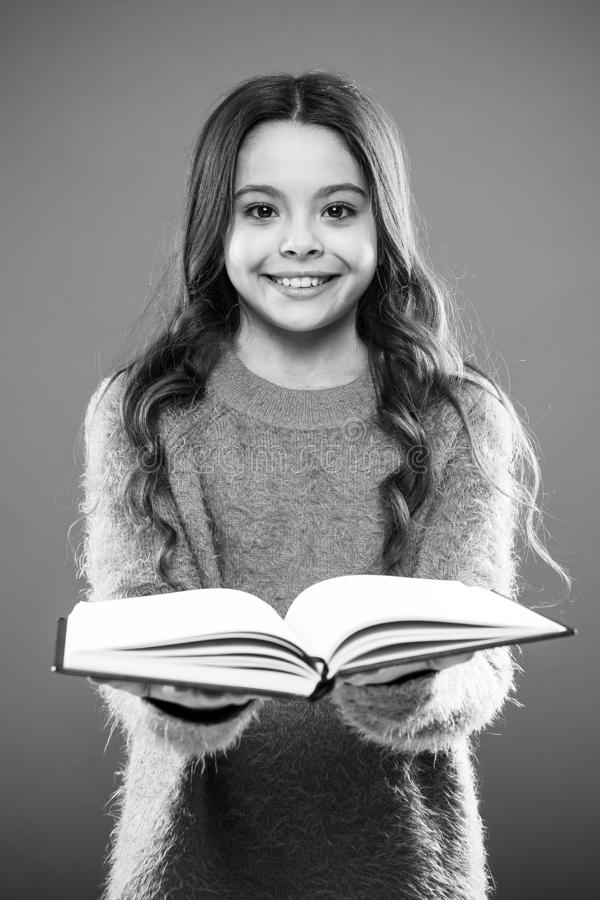 Girl hold book read story over orange background. Child enjoy reading book. Book store concept. Wonderful free childrens. Books available to read. Reading royalty free stock photos