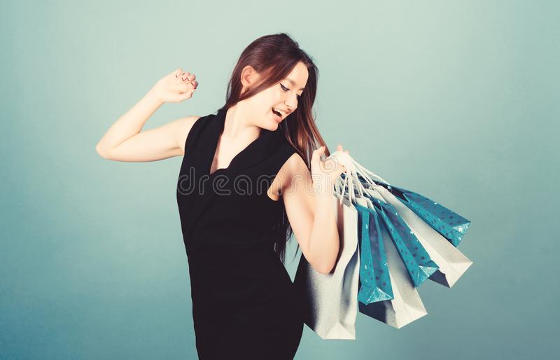 Girl hold bunch packages. Discount and special offer. Black friday shopping. Obsessed with purchase. Beautiful woman stock photos