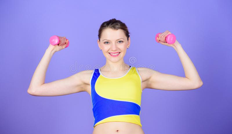 Girl hold dumbbells. Biceps exercises for female. Sport is the way of her life. Healthy lifestyle concept. Woman. Exercising with dumbbells. Fitness exercises royalty free stock photos