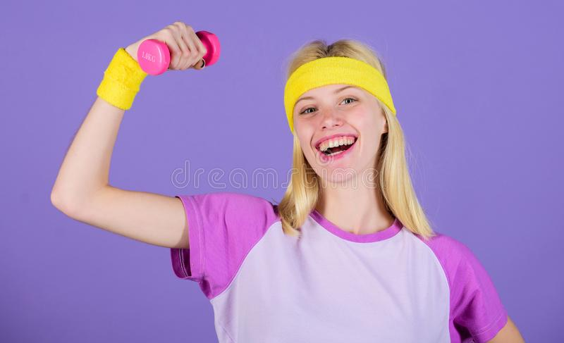 Girl hold dumbbells wear wristbands. Vintage sport concept. Woman exercising with dumbbells. Easy exercises with. Dumbbells. Workout with dumbbells. Biceps stock image