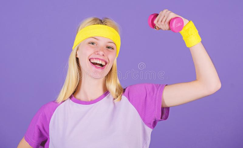Girl hold dumbbells wear wristbands. Vintage sport concept. Woman exercising with dumbbells. Easy exercises with. Dumbbells. Workout with dumbbells. Biceps royalty free stock photo